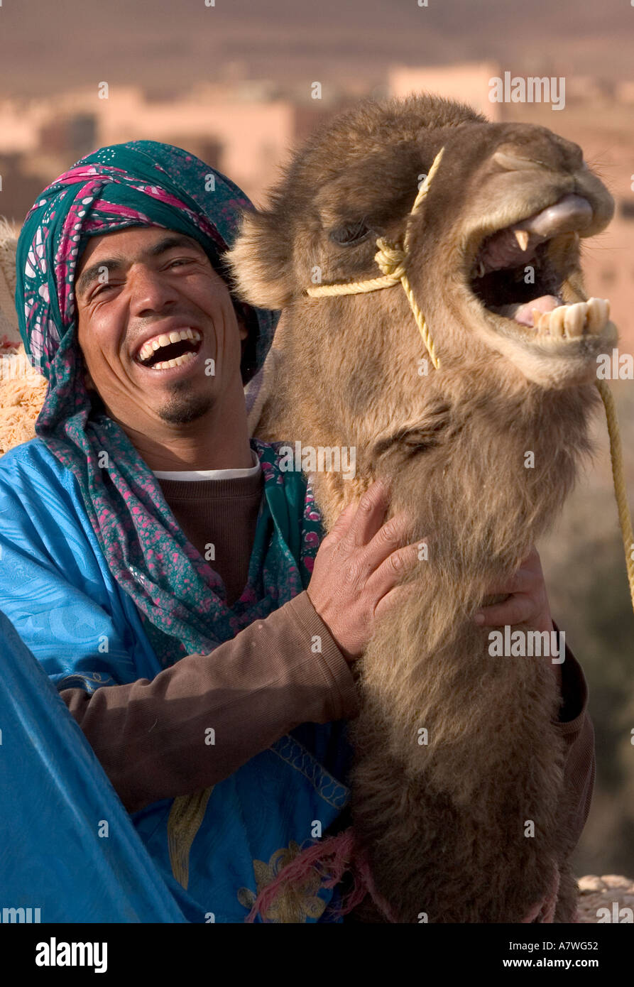 a-man-and-his-camel-laugh-as-they-sit-in