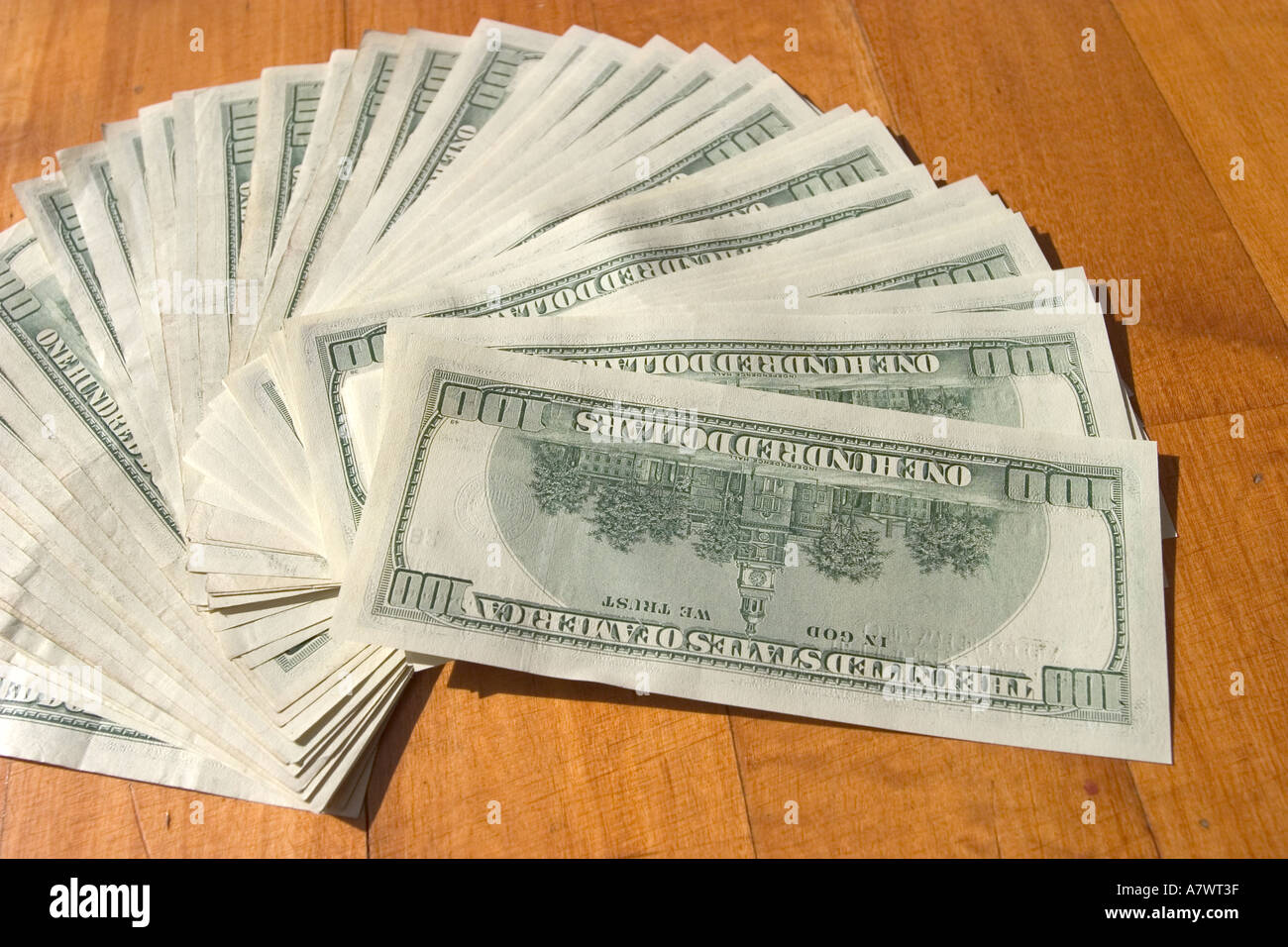 Stock Photo   Aligned 5000 Dollars In Cash In One Hundred American Currency  Dollars