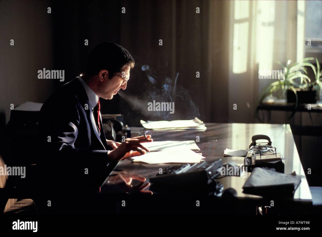 sunlight window office executive worker smoke smoking desk organize. Black Bedroom Furniture Sets. Home Design Ideas