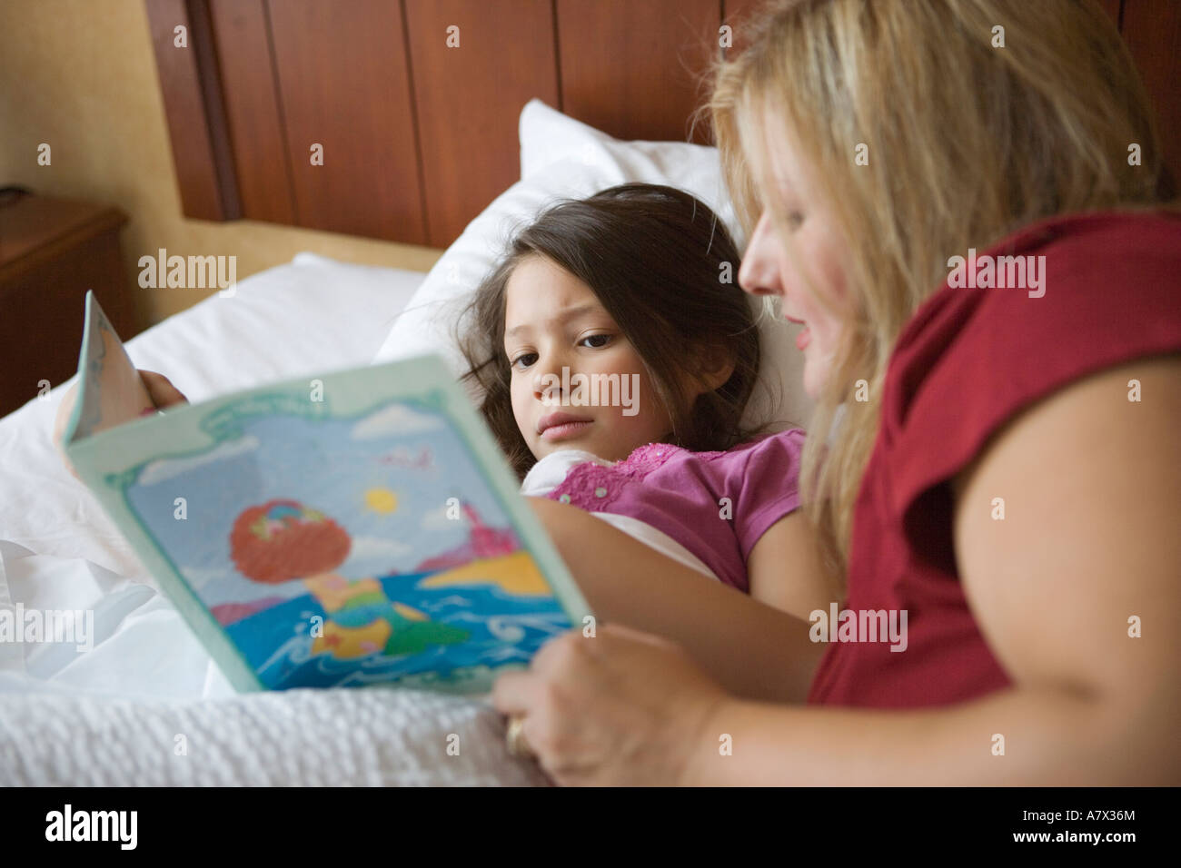Mother reading bed time story to her six year old daughter for Bed stories online