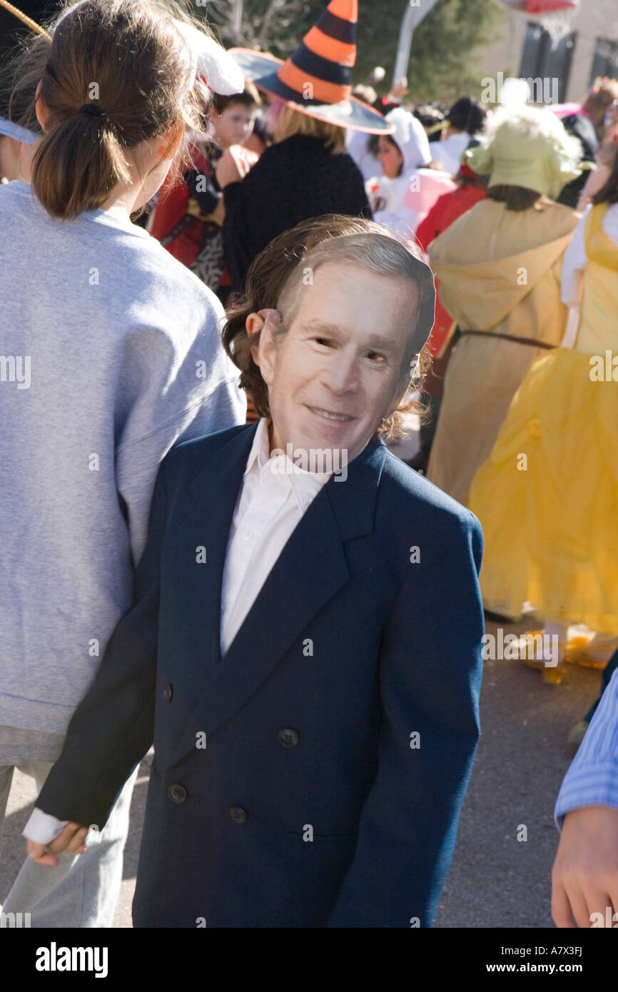 child wearing costume with mask of president george bush during ...