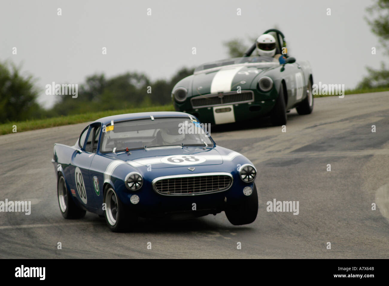 Richard conklin in his 1968 volvo p1800 followed by donald dickey in his 1963 mgb at
