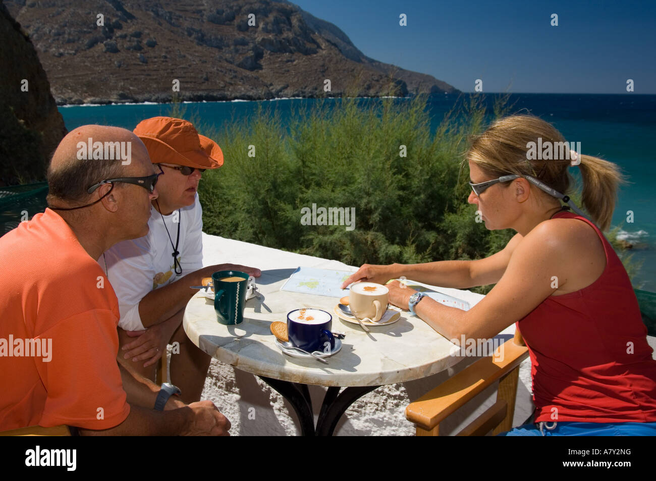 Tourists looking at a map Linaria Kalymnos island Dodecanese