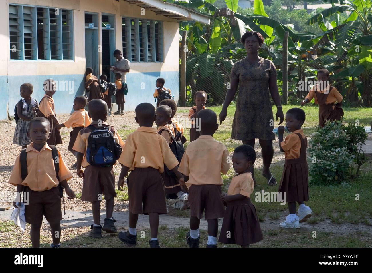 Mixed group of kindergarten school children arriving at ...