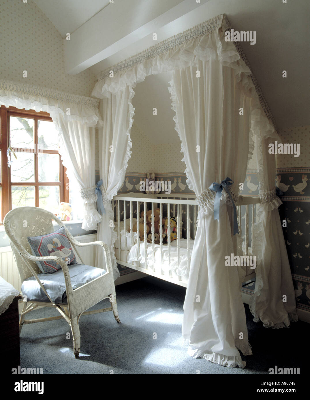 White Cotton Drapes Above Baby S Cot In Attic Nursery