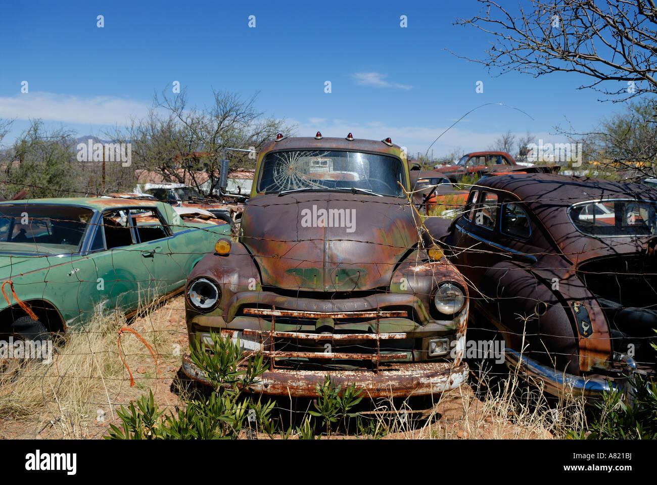 Old Chevrolet pickup sits abandoned in desert junkyard Stock Photo ...