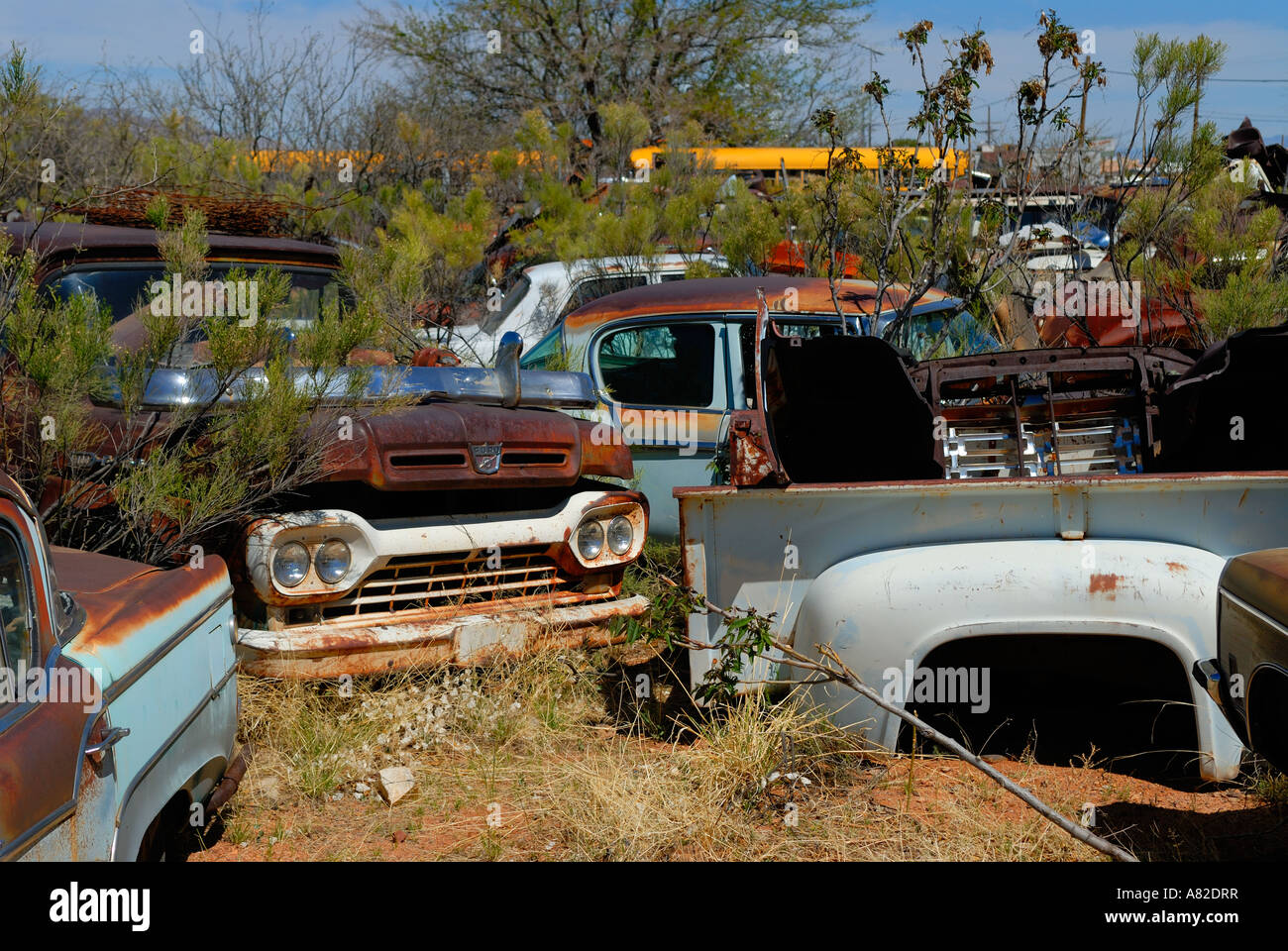 Old Ford pickup truck sits abandoned in desert junkyard Stock Photo ...
