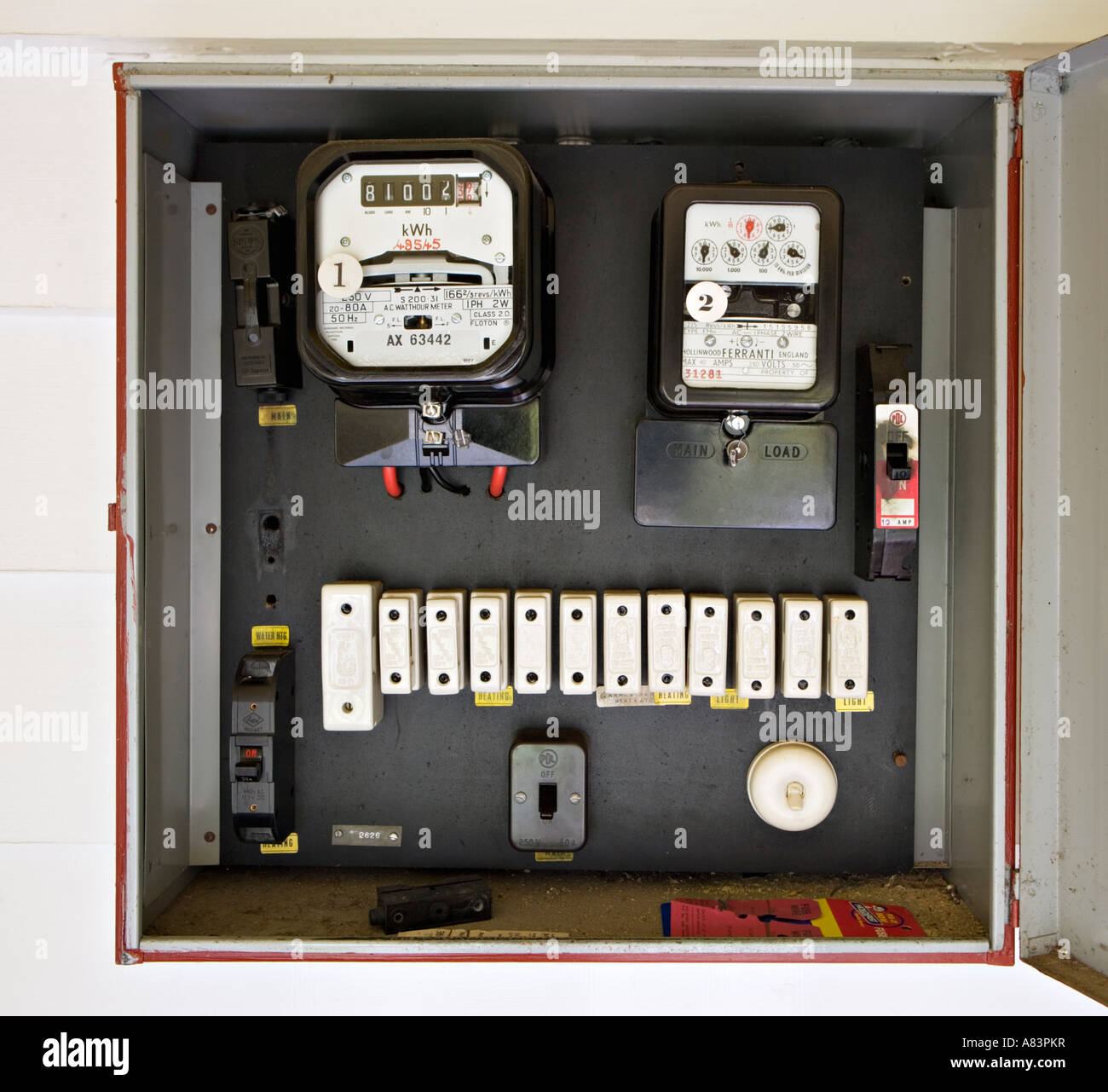 electricity meter in box with old style fuses circa 1962 in new zealand A83PKR old fuse box with an electricity meter and electrical wiring on a Old Fuse Box Parts at n-0.co
