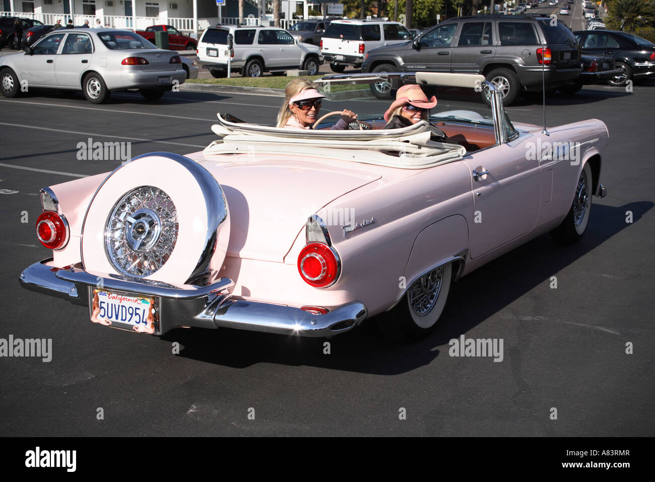 Stock photo two ladies sitting in pink original 1956 ford thunderbird t bird convertible del mar california usa