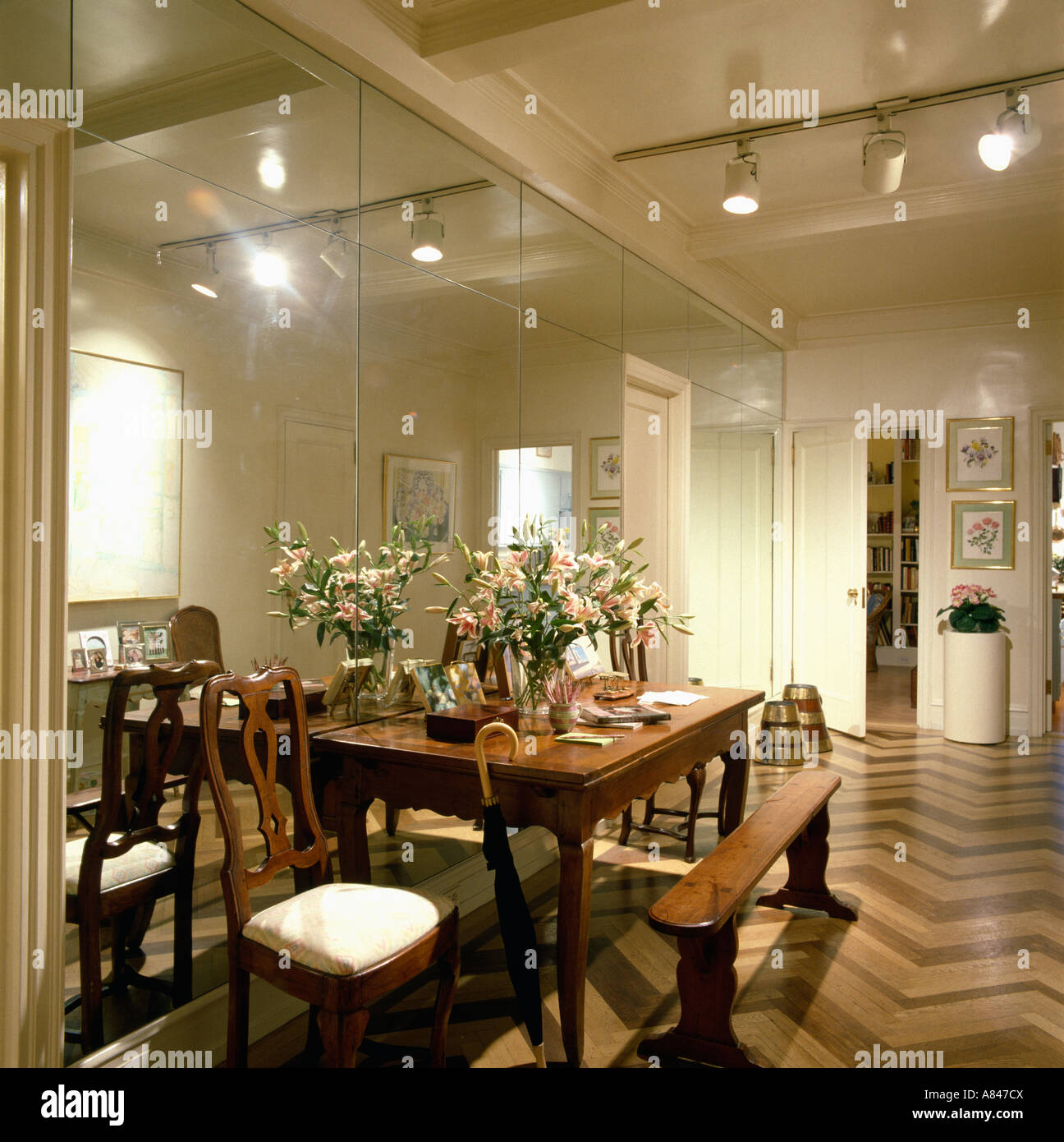Antique wooden bench and dining table in hall with ceiling ...