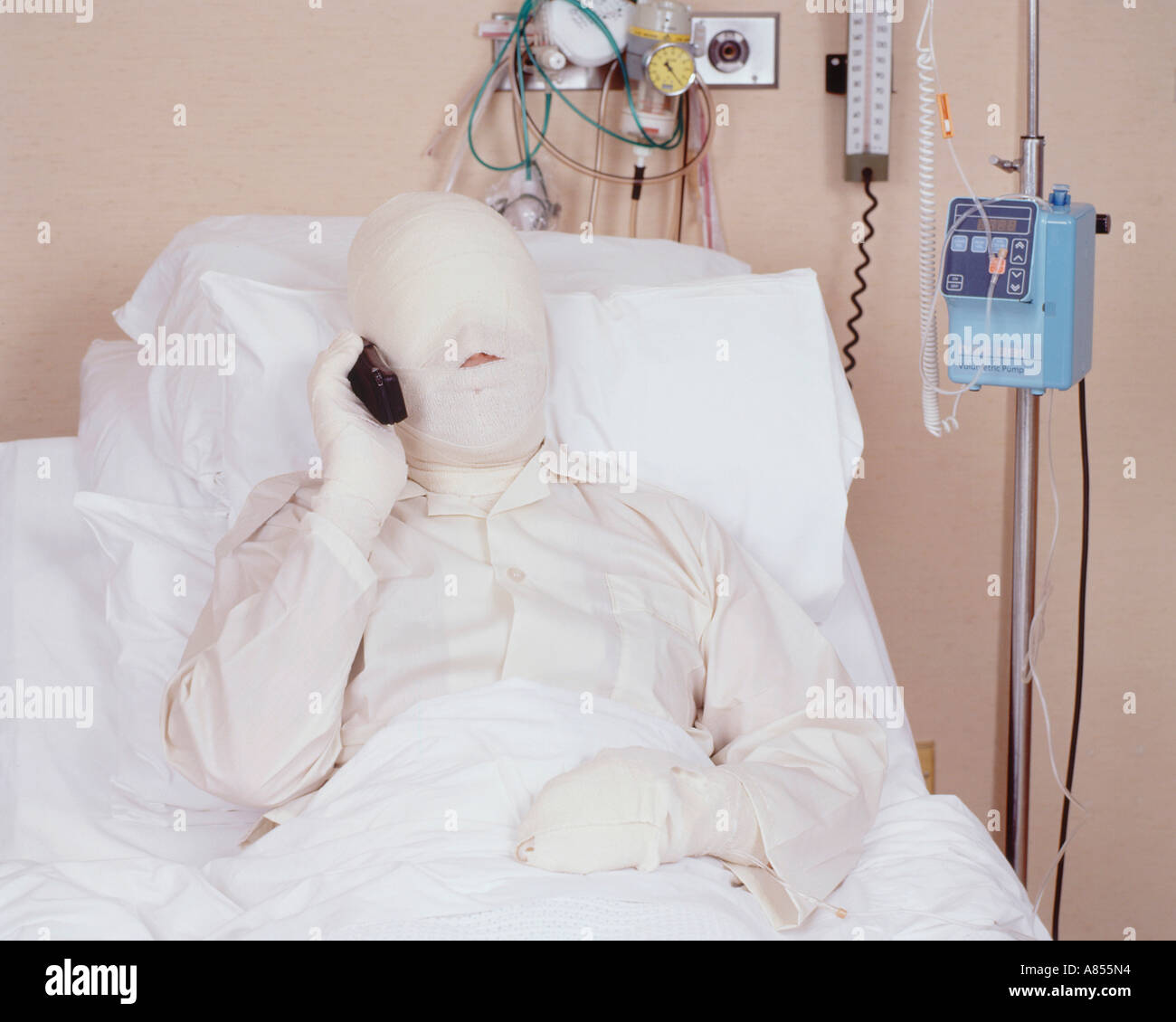 closeup of male patient in hospital bed with serious