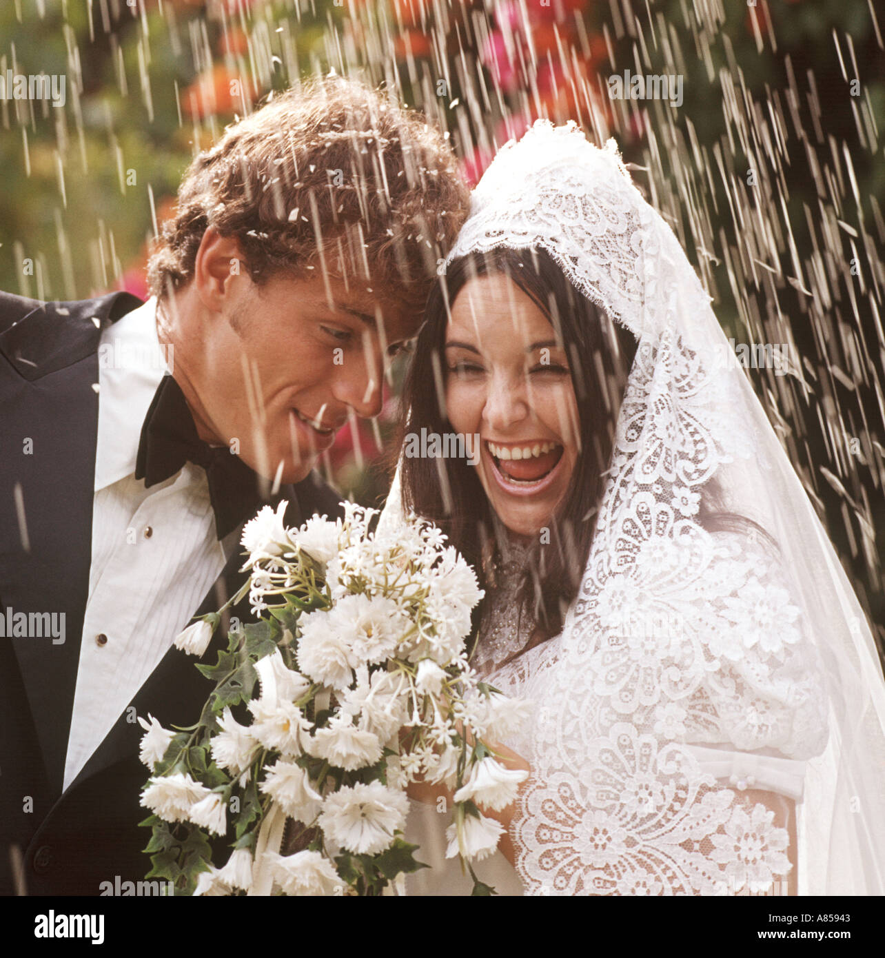 Wedding Couple Being Showered With Rice After Ceremony