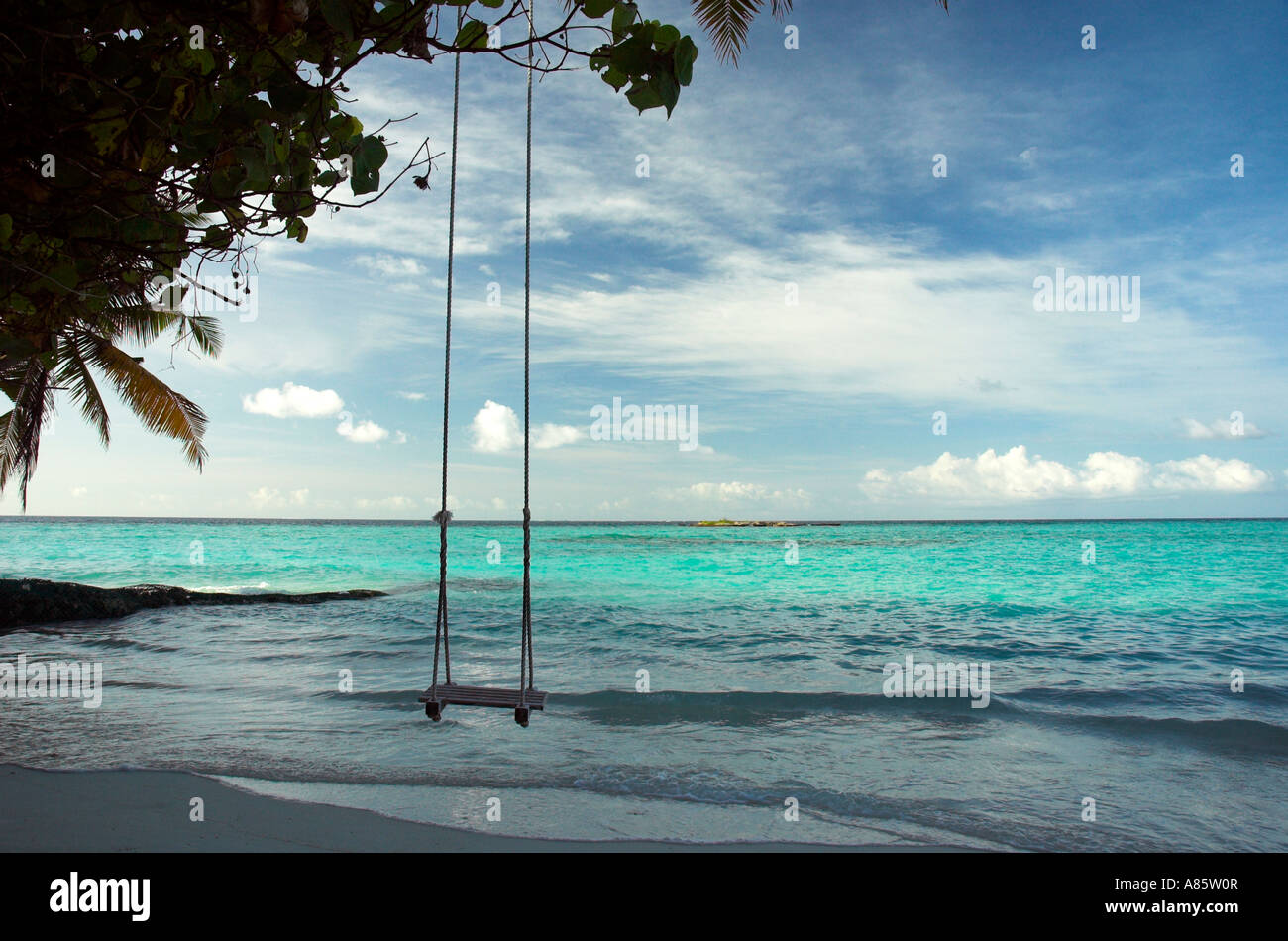 A beach swing over the shallow water of the sea in the for Swing over water