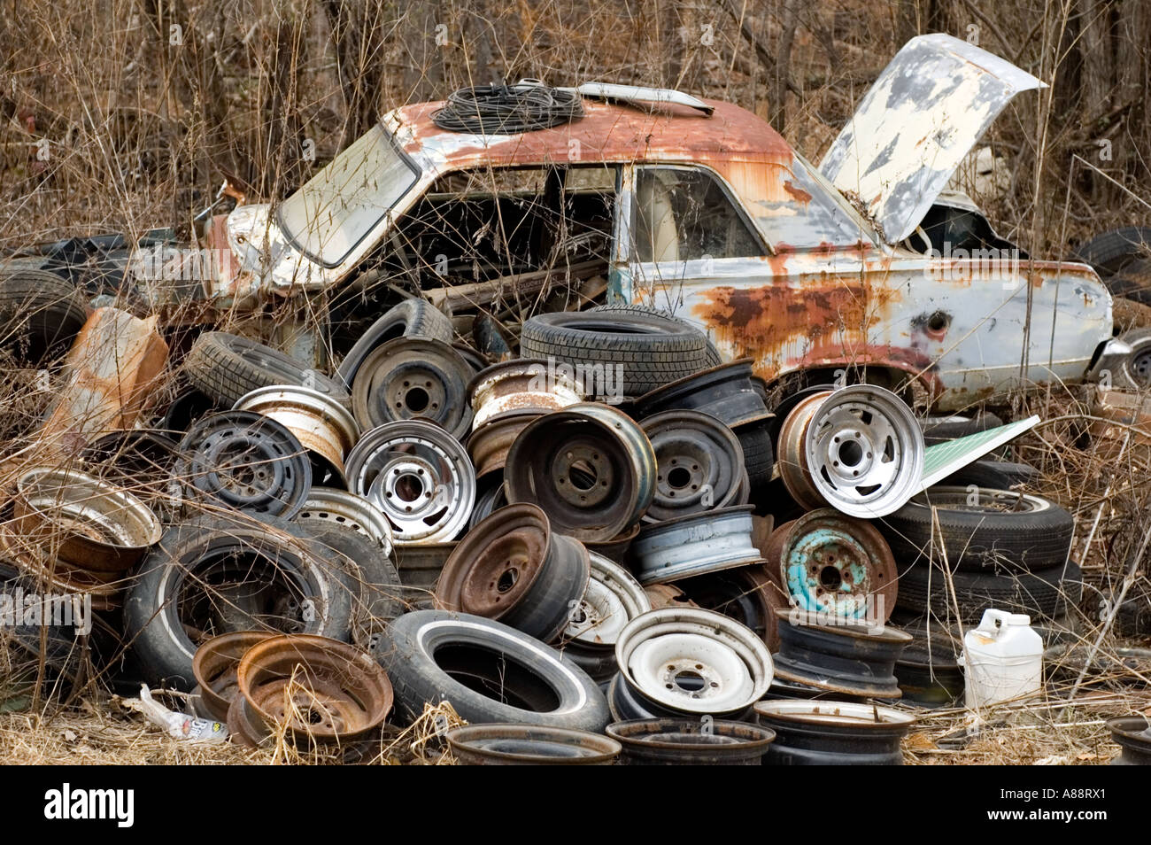 Pile of Old Wheels in Front of Rusting Car at Sonnys Junk Yard ...