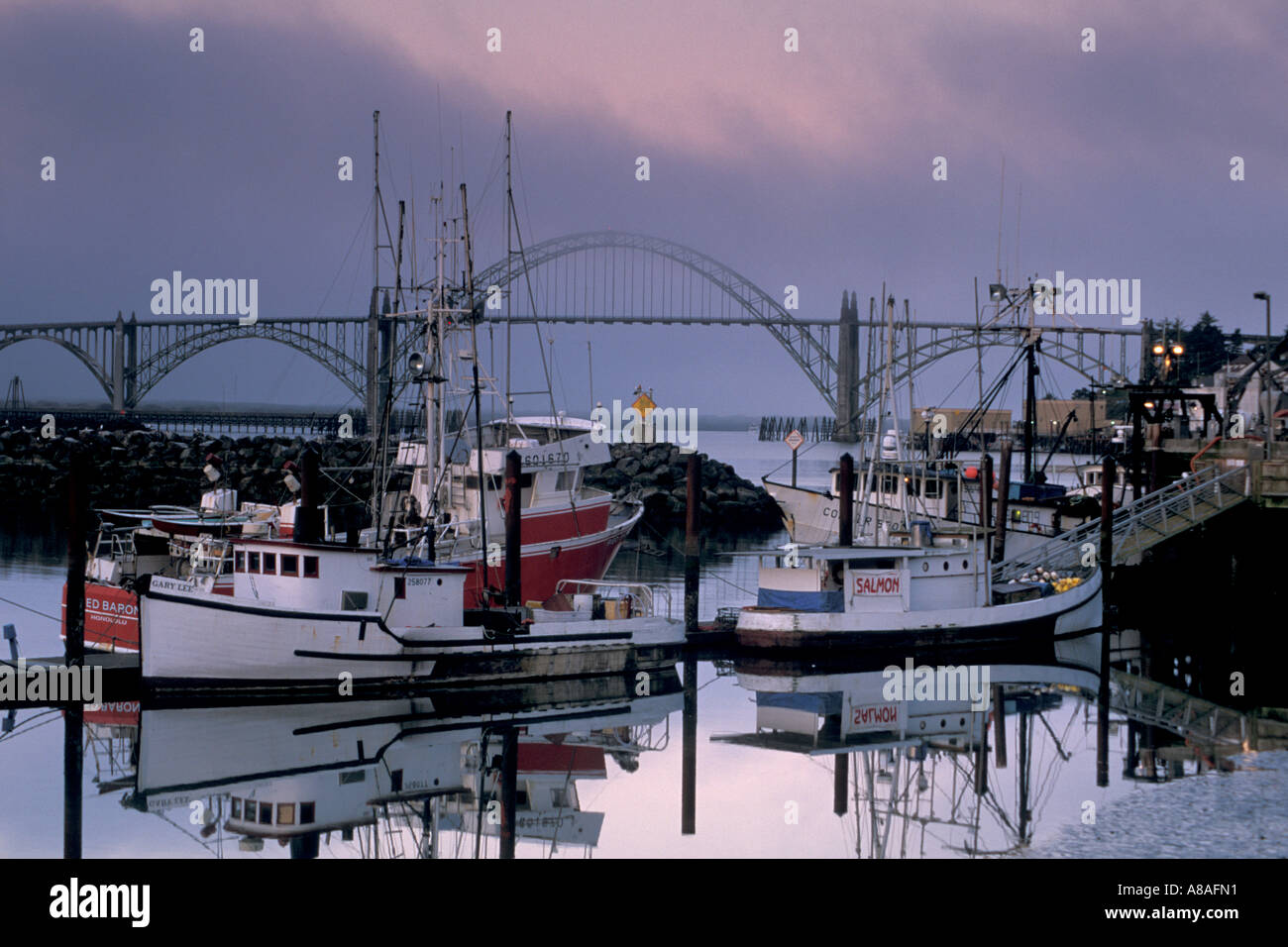 Fog at dawn over commercial fishing boats in harbor and for Newport oregon fishing