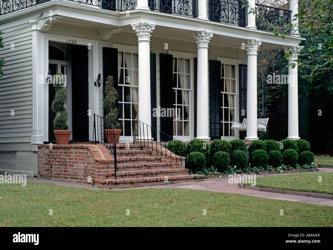 Front Porch With Columns Of A Southern Style Mansion In The Garden