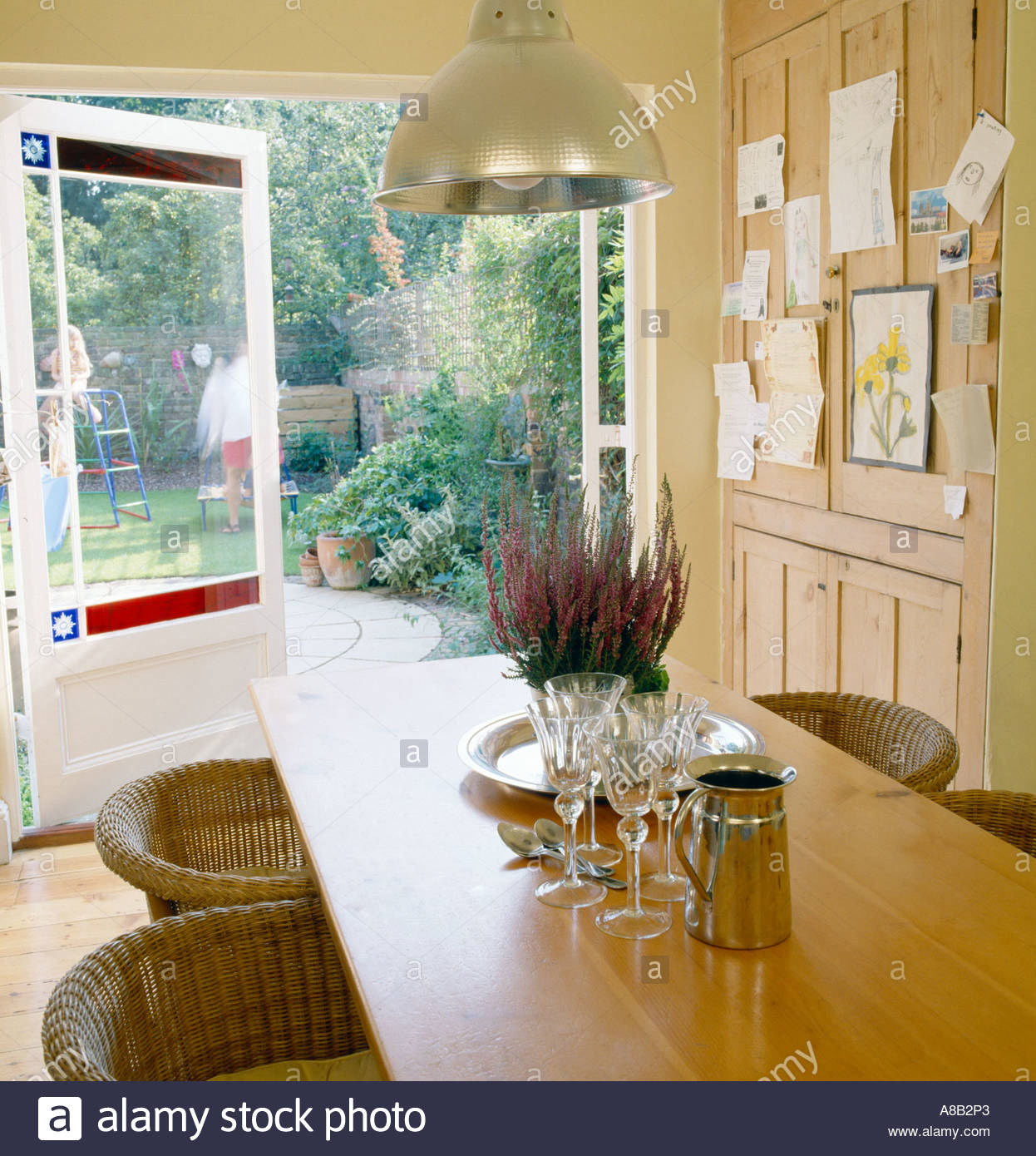 Kitchen Table In Kitchen With French Doors Leading To Garden