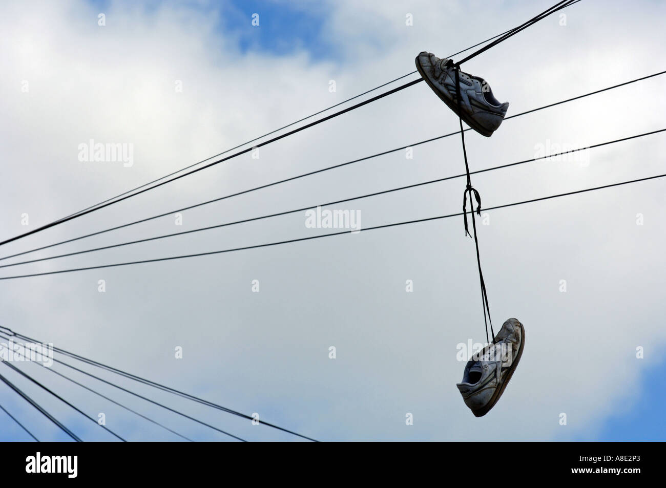 Shoes hanging from telephone wire Stock Photo, Royalty Free Image ...