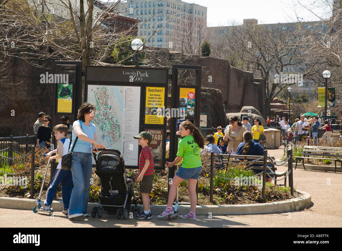 CHICAGO Illinois Mother with stroller and children map at entrance