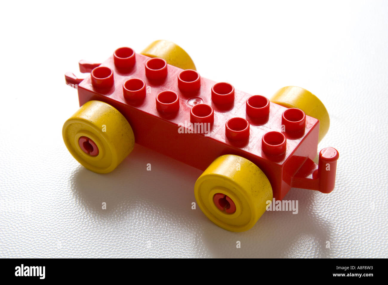 toy lego toy car wheels yellow red close up