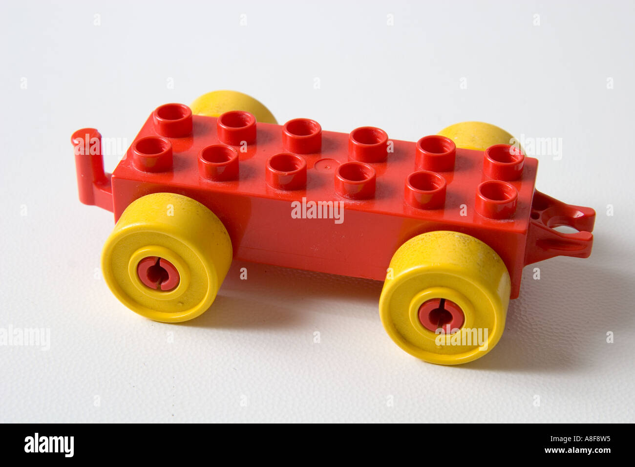 stock photo toy lego toy car wheels yellow red close up white background kids play