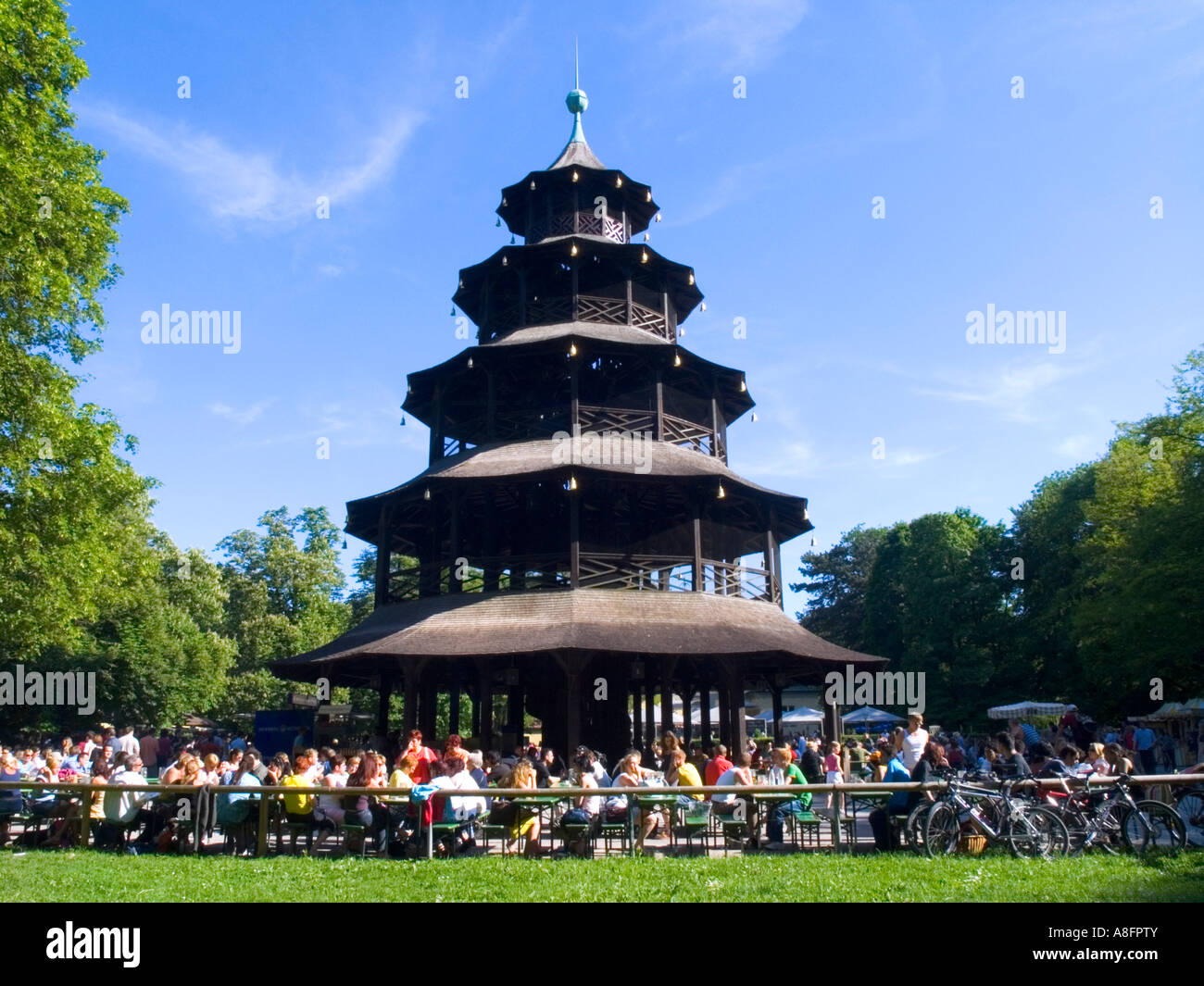people enjoy beer in beer garden chinese tower english garden munich stock photo royalty free. Black Bedroom Furniture Sets. Home Design Ideas