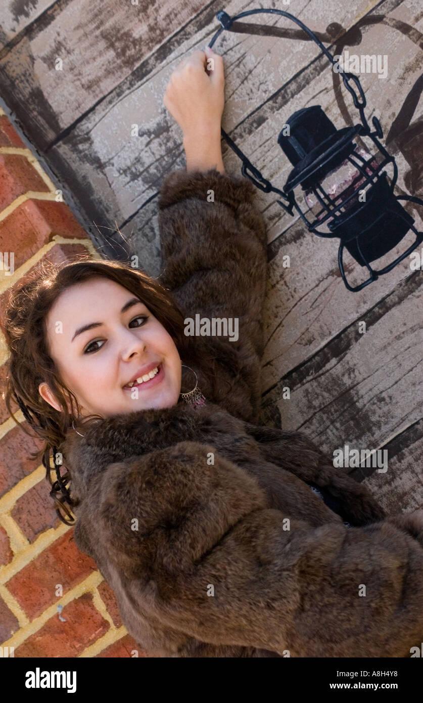 Caucasian teen girl 13 to 15 years wearing fur coat and - Traumzimmer fur teenager ...