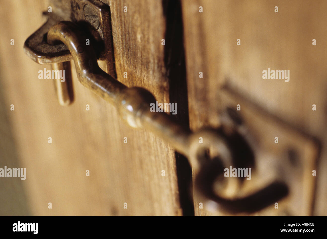 Close up of old latch or hook on wooden door or cabinet Stock ...