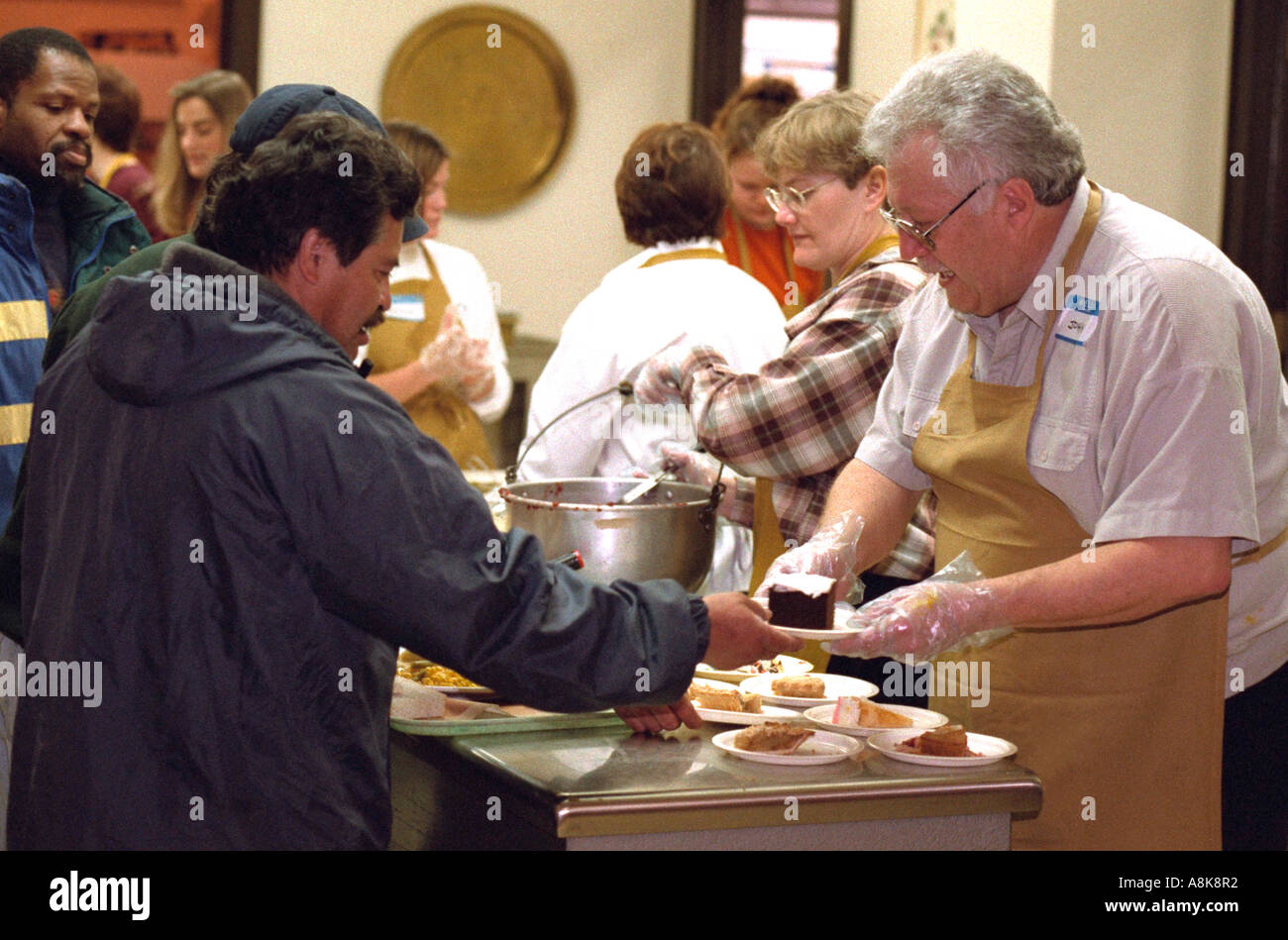good Volunteer Soup Kitchen Thanksgiving #6: Stock Photo - Volunteers serving Exchange Charities Thanksgiving soup kitchen dinner. Minneapolis Minnesota USA