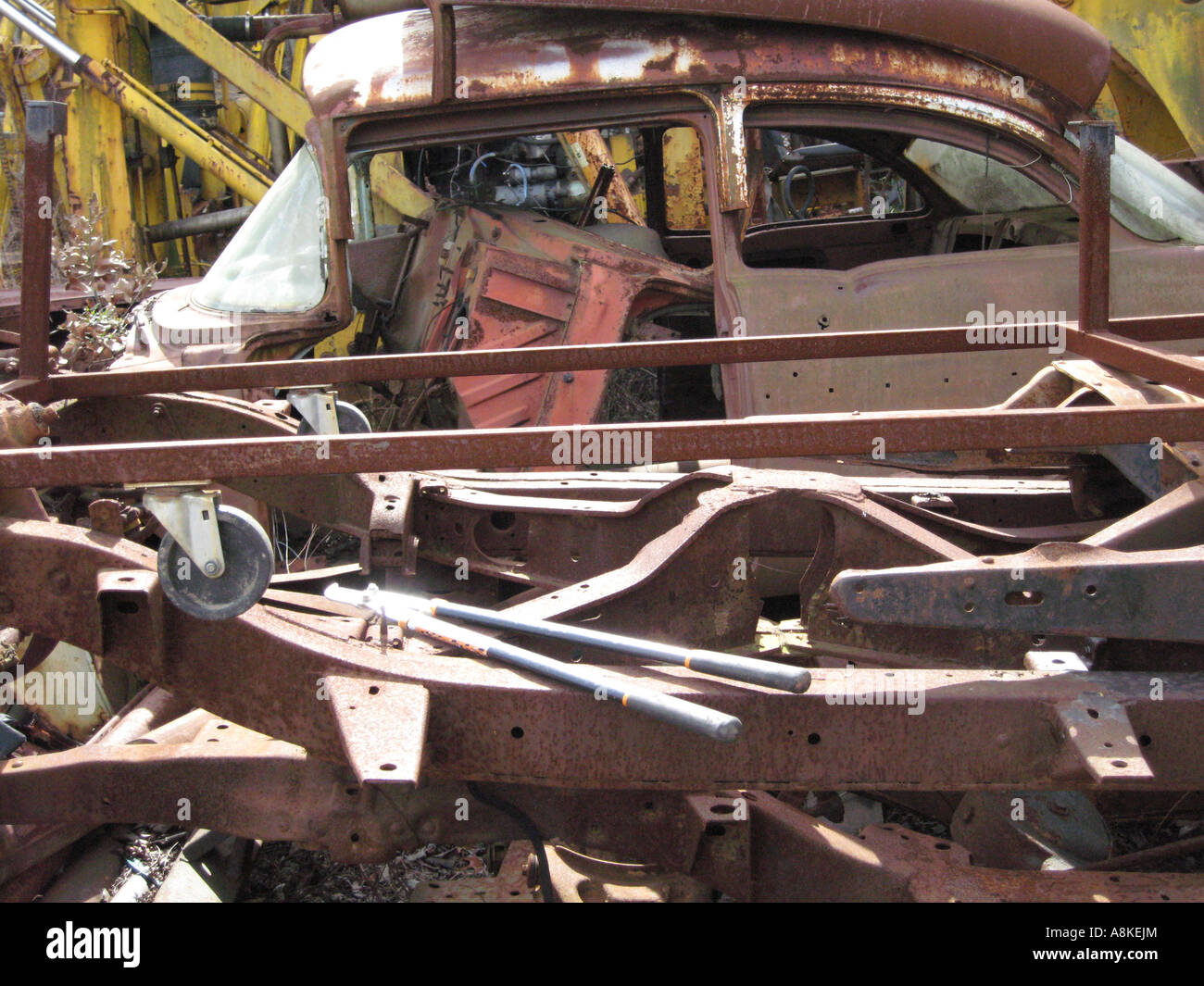 Old automobile graveyard with rusty frames and junked cars Stock ...