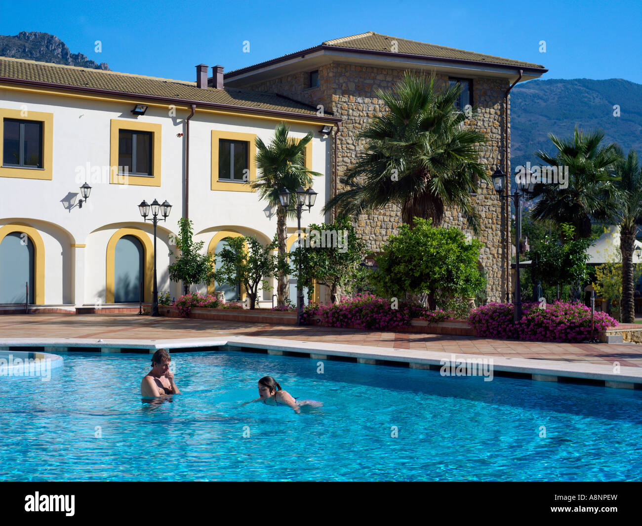 Palermo sicily italy genoardo park hotel swimming pool people stock photo royalty free image for Hotels in bologna italy with swimming pool