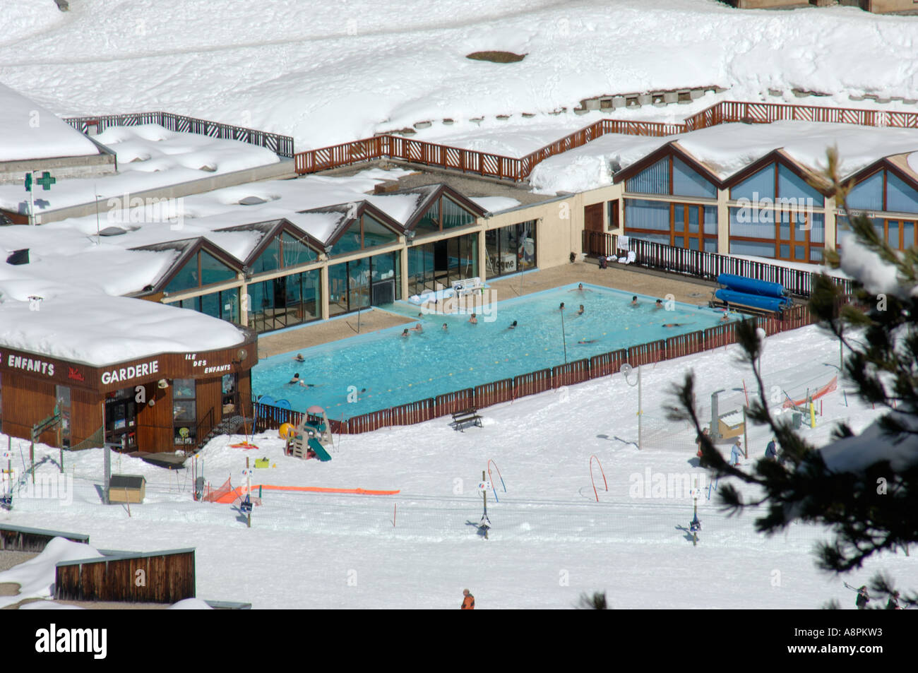 Heated outdoor swimming pool set in snow at french ski for Heated garden swimming pools
