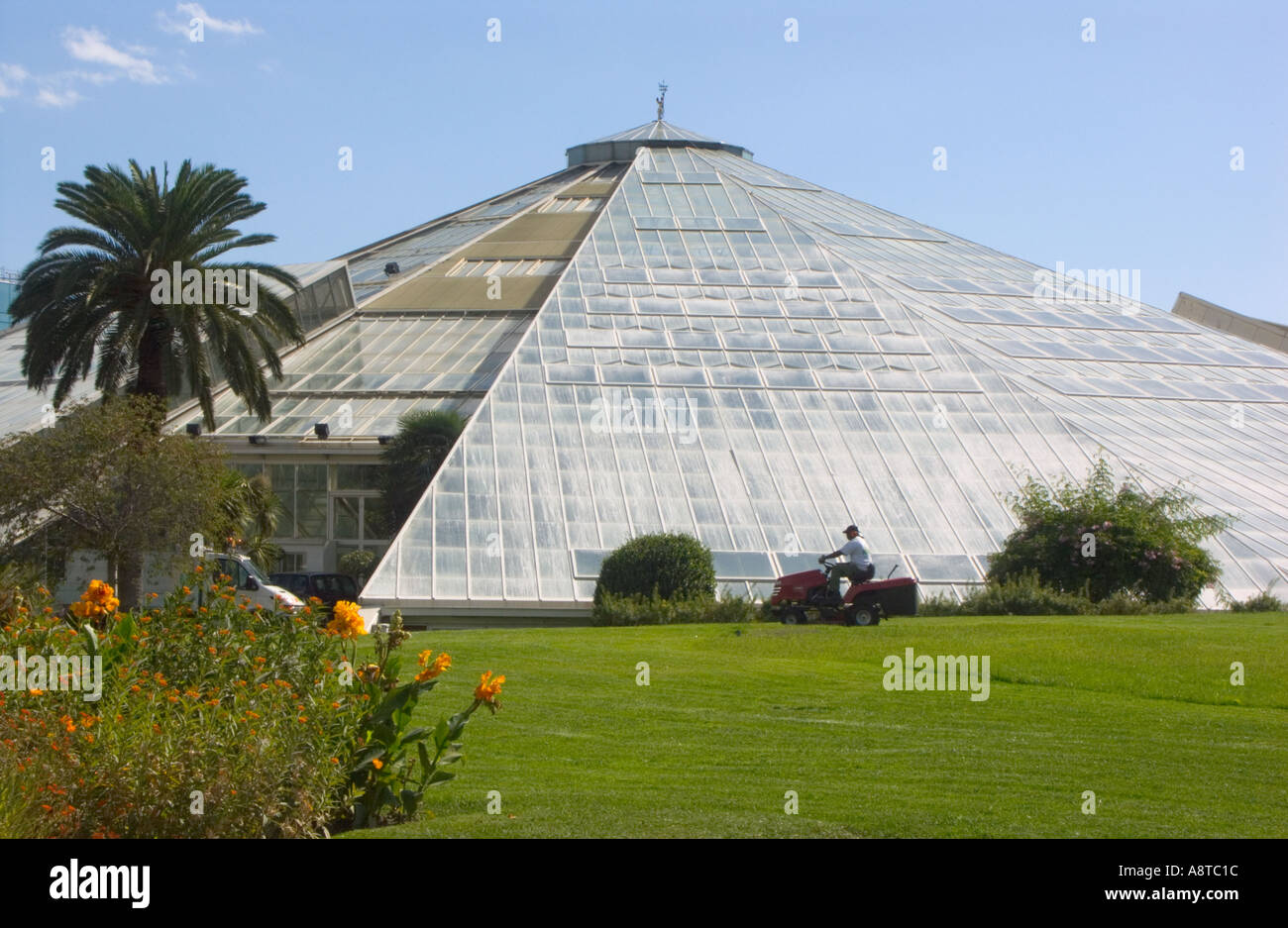 Mowing lawns at parc phoenix nice france with glasshouse