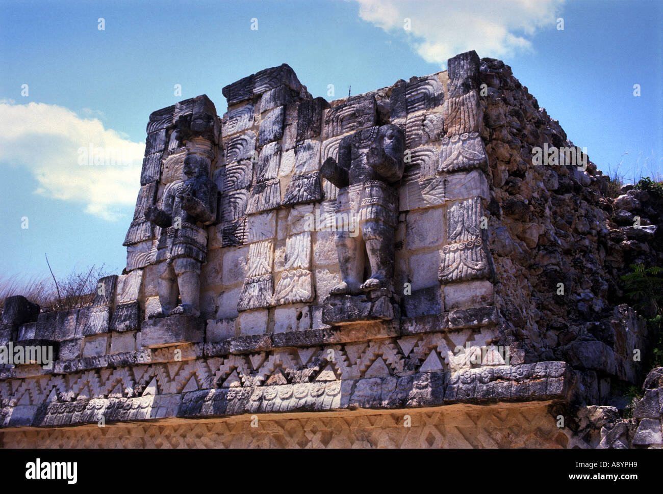 TWO ATLANTEAN FIGURES ABOVE A DOOR AT THE REAR OF THE PALACE OF THE MASKS AT KABAH YUCATAN MEXICO & TWO ATLANTEAN FIGURES ABOVE A DOOR AT THE REAR OF THE PALACE OF ...