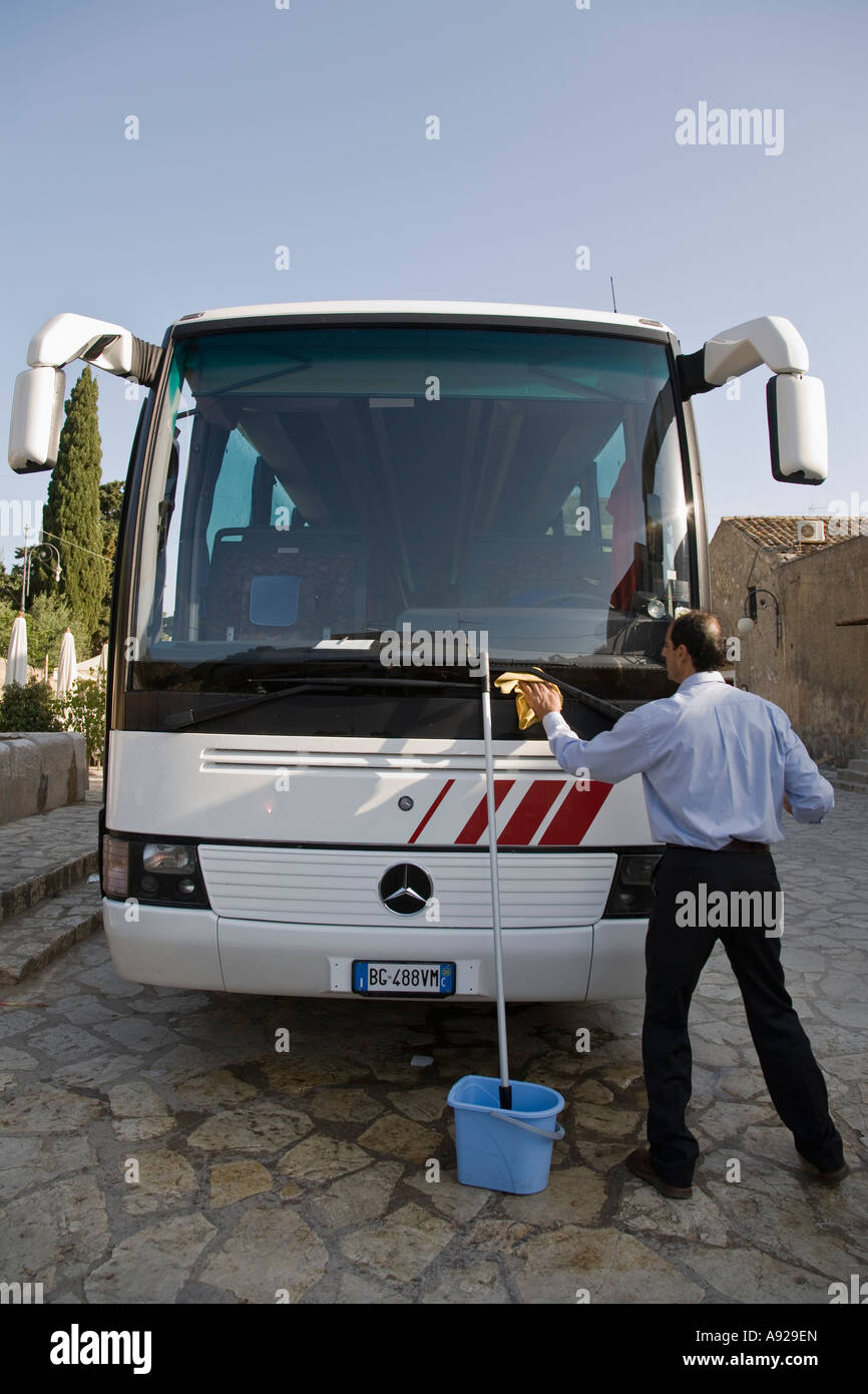 Tour bus driver washing windshield of bus scopello sicily for Motor coach driving jobs