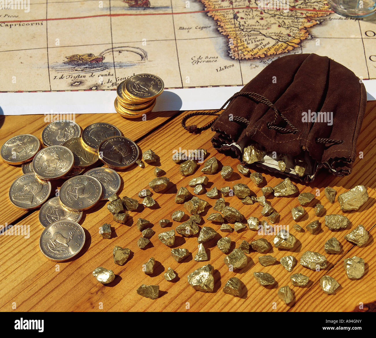 Kruger rand stock photos kruger rand stock images alamy kruger rand gold coins and gold ingots spread over a wooden table with an old map buycottarizona