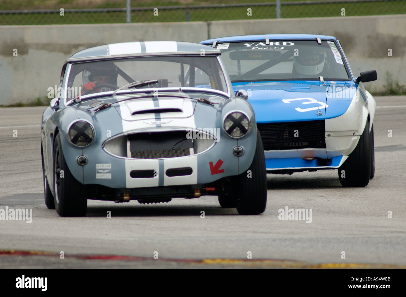 Bob dillon races his 1957 austin healey 100 6 followed by richard bob dillon races his 1957 austin healey 100 6 followed by richard blaha in his 1970 datsun 240z at the vintage gt challenge 2005 vanachro Gallery