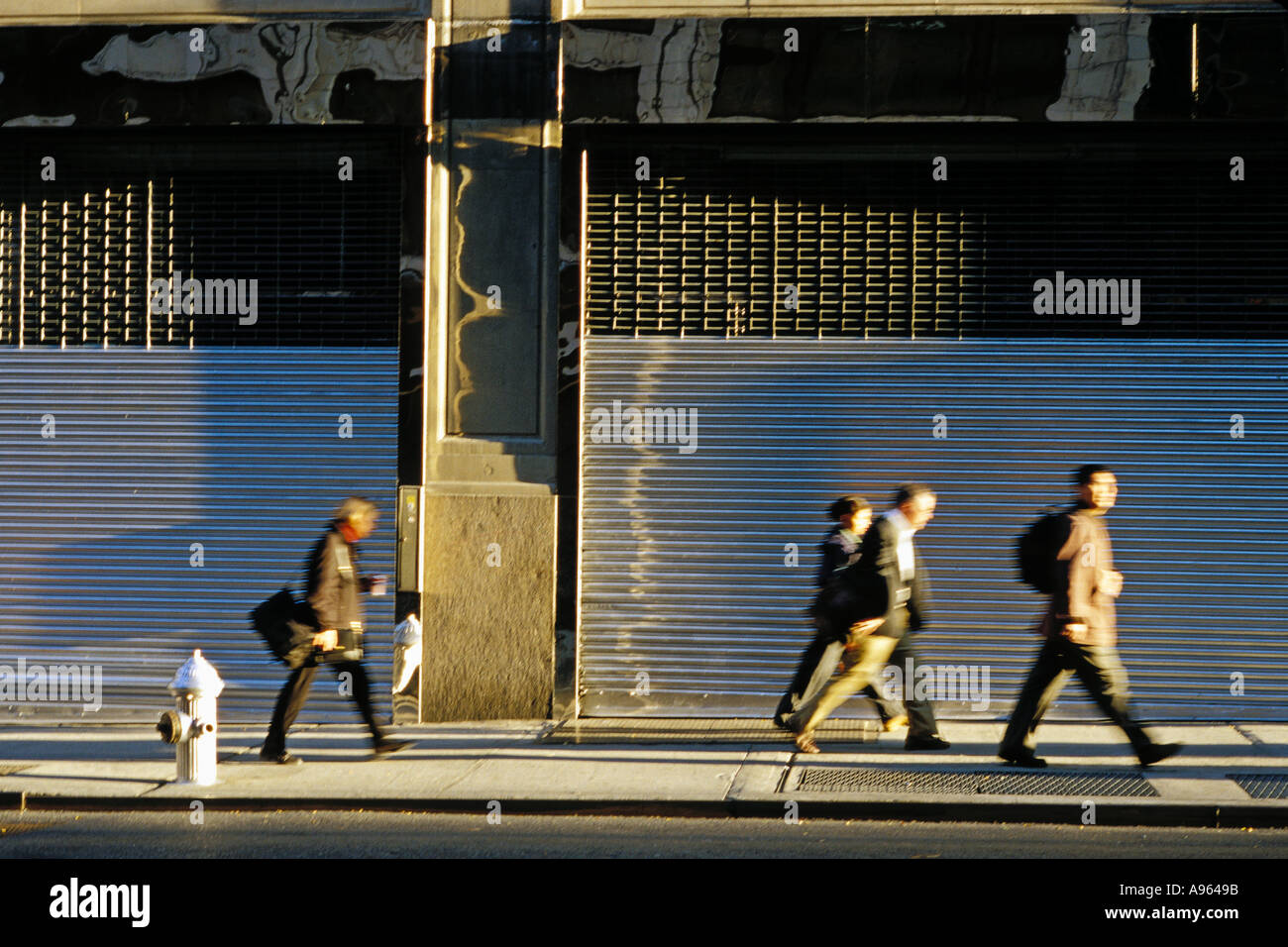 people walking to work in early morning light on th street people walking to work in early morning light on 39th street midtown manhattan new york ny