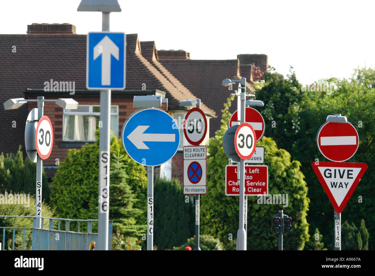 confusing road signs in surrey england stock photo