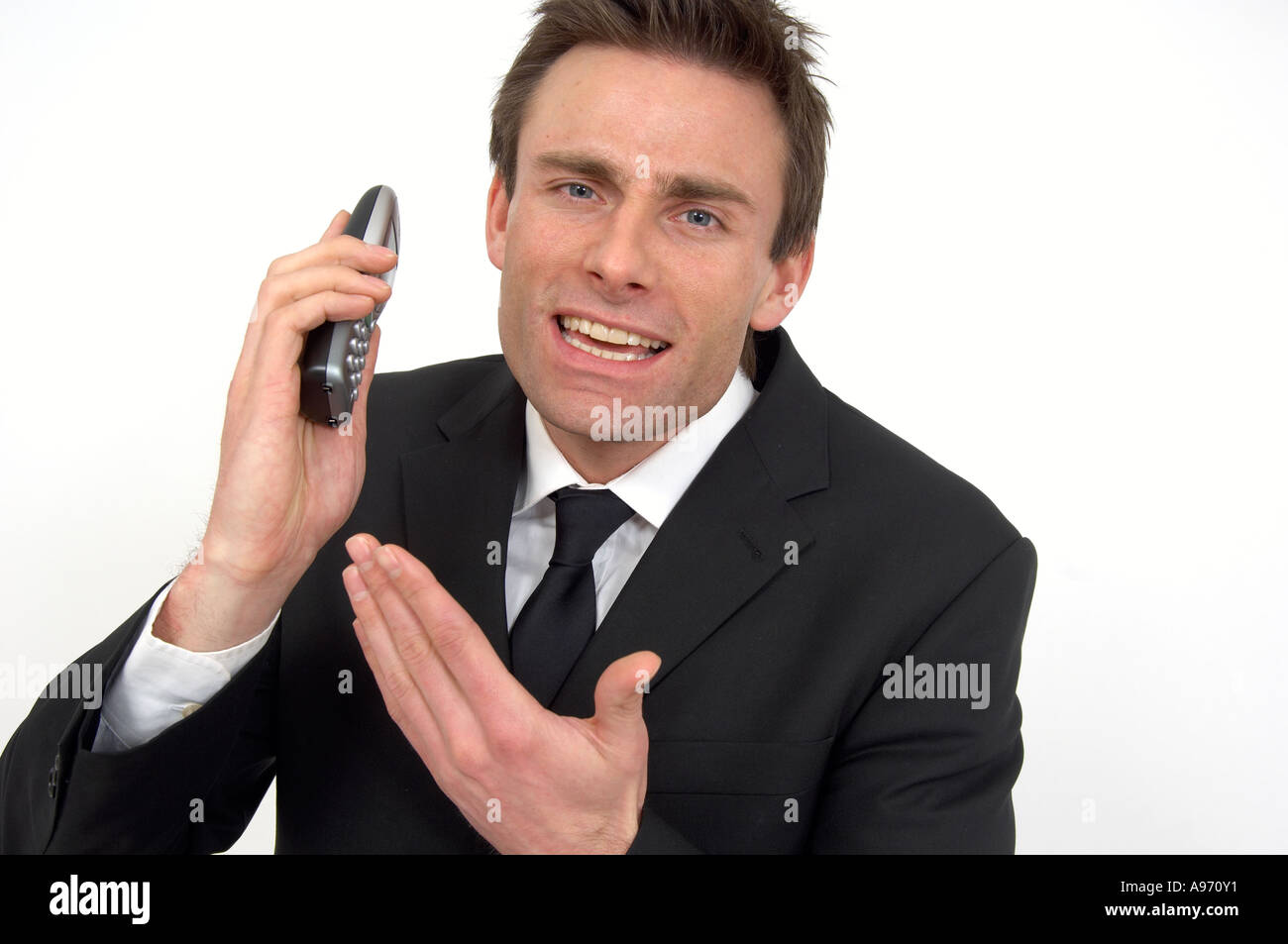 Frustrated office worker on the phone holding stock photo image - Stock Photo Fed Up Man On The Telephone Frustrated