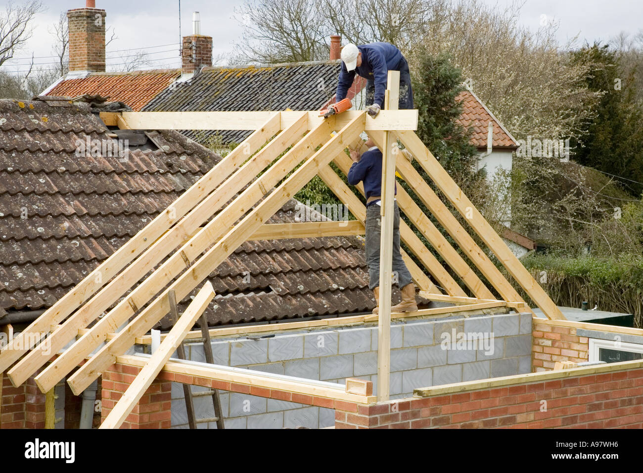 Nice Stock Photo   Builders Contructing A New Roof For An Extension To A Home