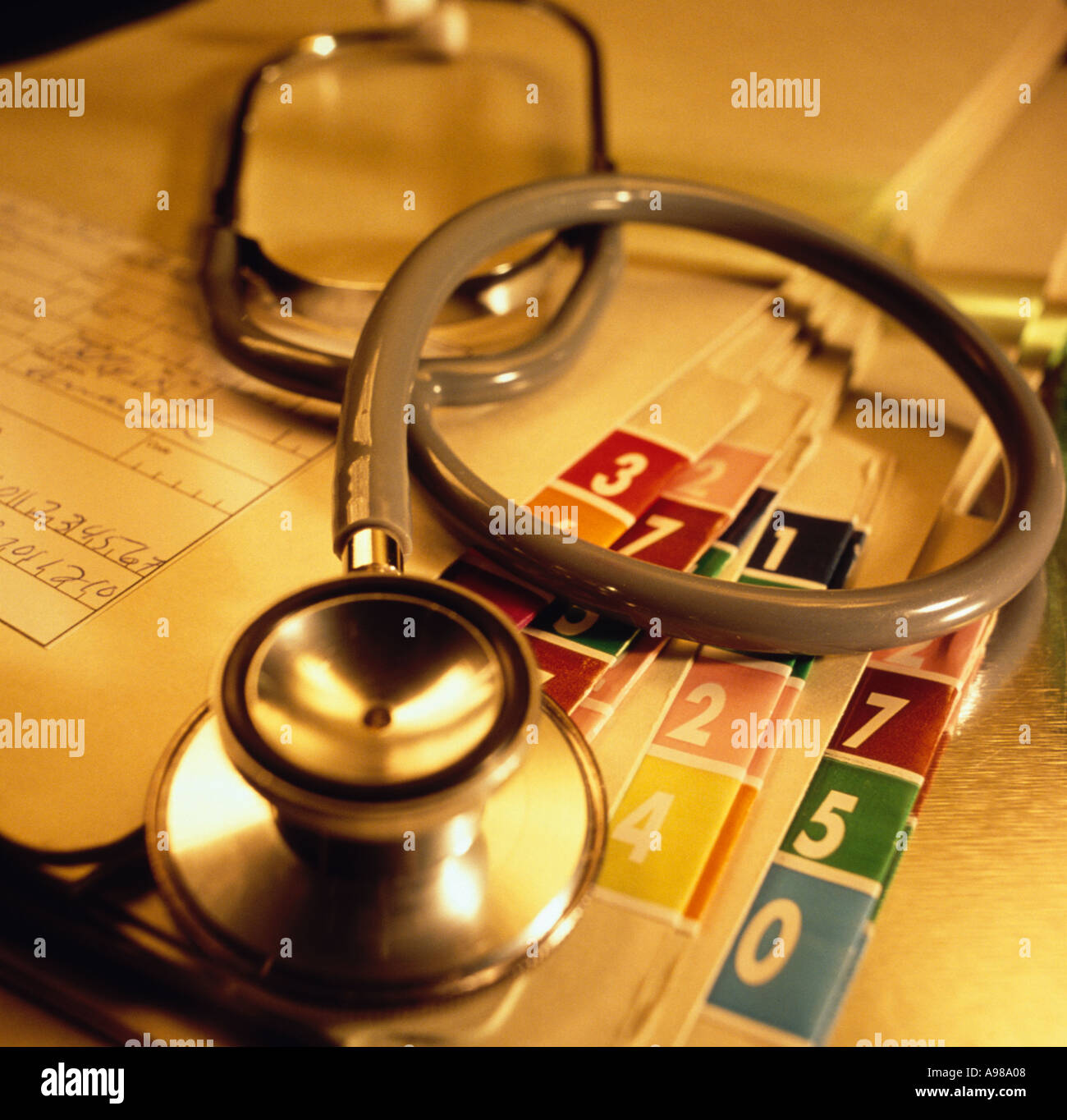 A Doctor Stethescope Laying On A Pile Of Patient Medical Charts