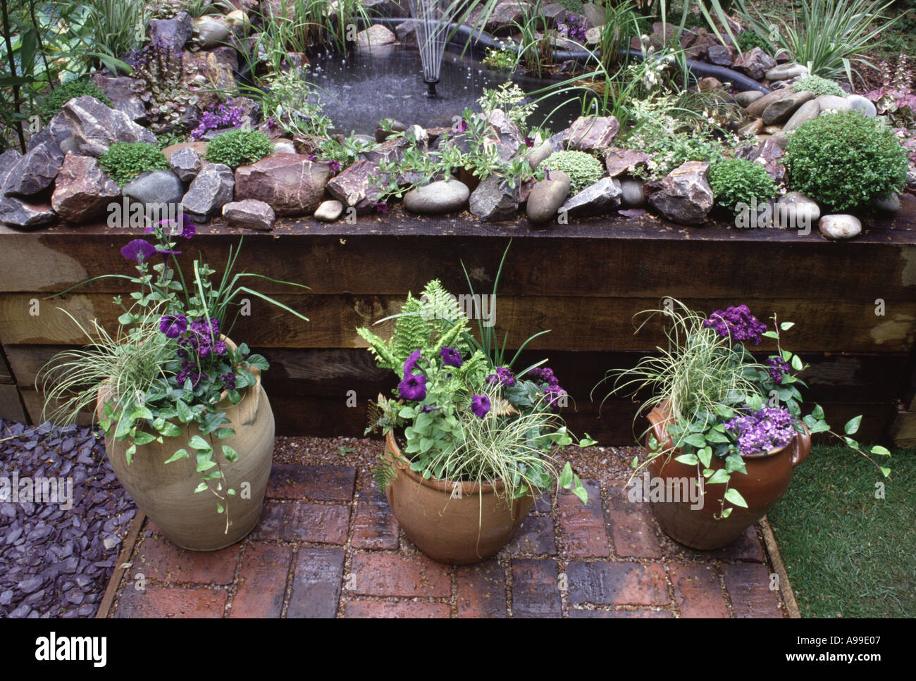 52 small garden pond with fountain hosta pots with ivy for Small garden pond with fountain