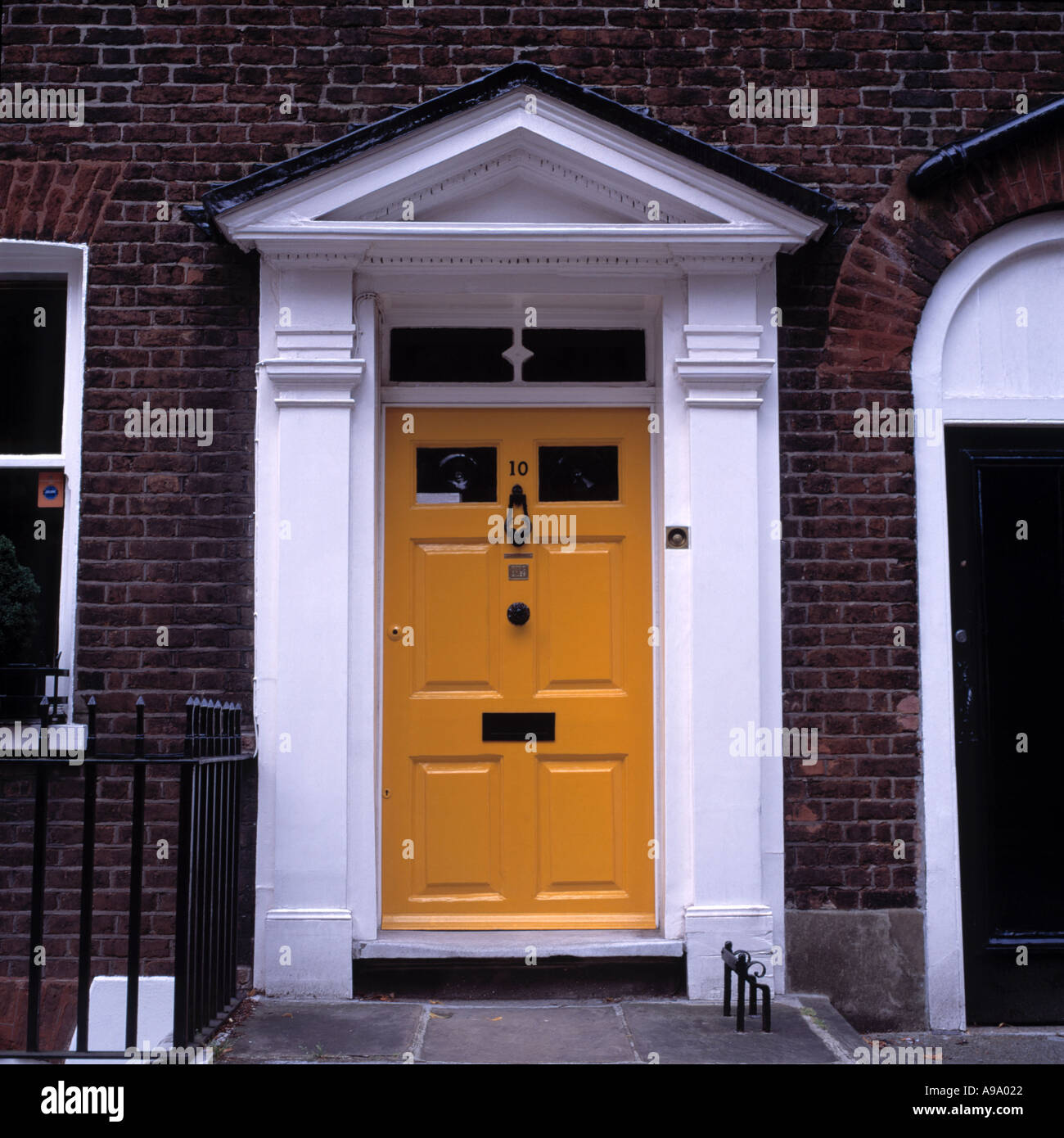 Front Porch Of Yellow House Stock Photo: Yellow Front Door With White Painted Portico On