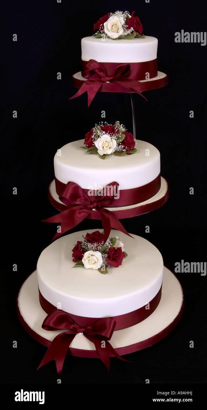 Three Tier Round Wedding Cake With Sugarflowers On A Chrome Stand