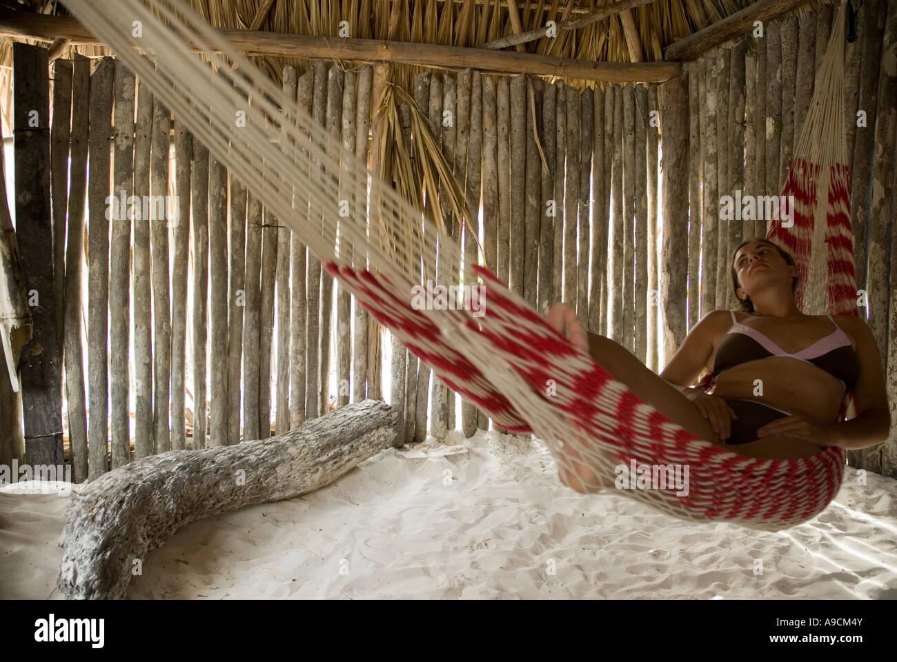 tulum caribbean woman inside a cabana hut lying in a hammock tulum caribbean woman inside a cabana hut lying in a hammock stock      rh   alamy