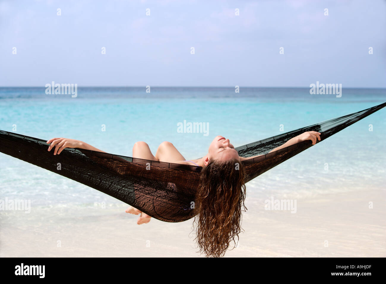 woman in black hammock at water s edge playa azul cozumel mexico woman in black hammock at water s edge playa azul cozumel mexico      rh   alamy