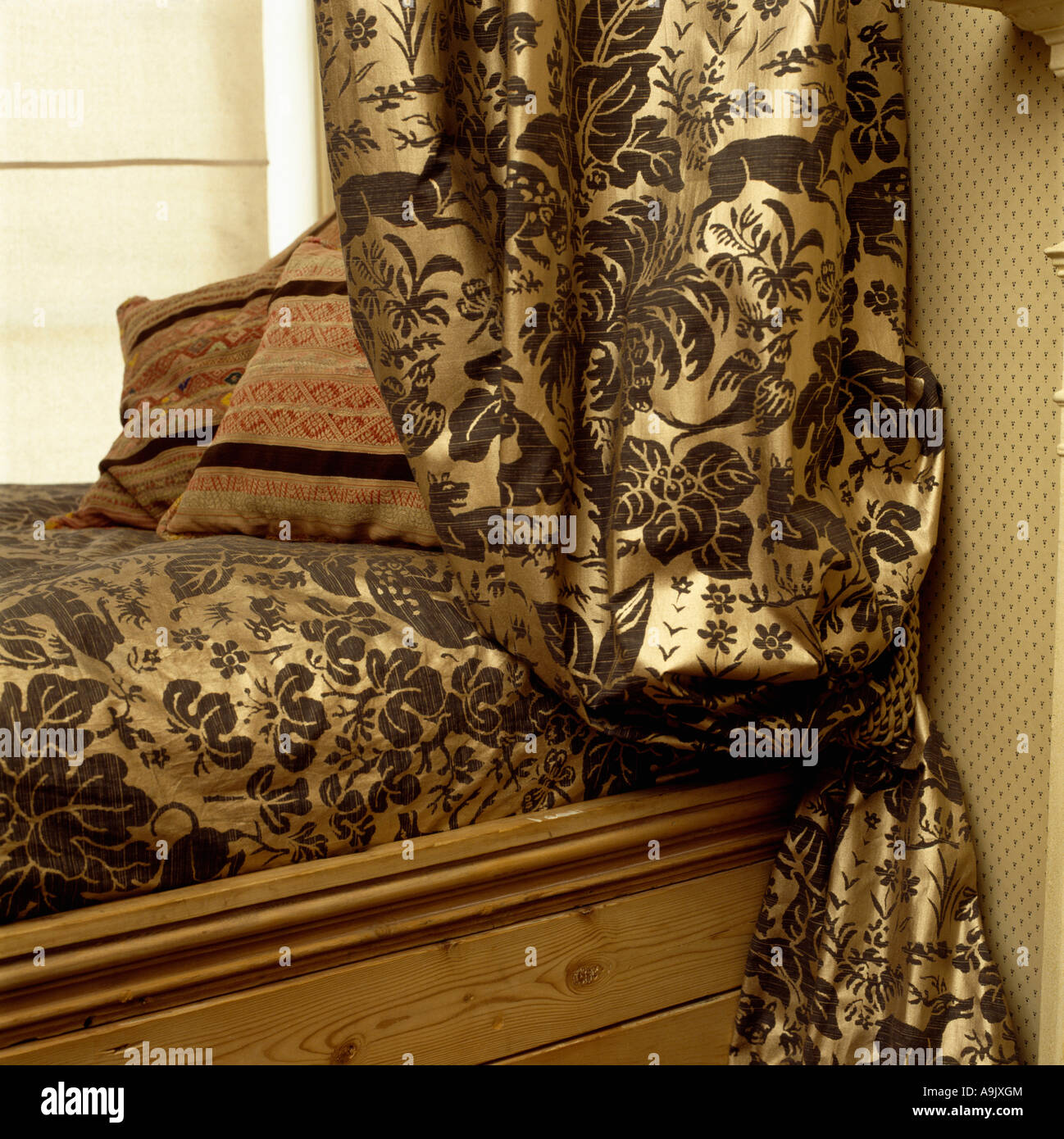 closeup of patterned gold silk curtains and matching bed cover stock photo - Patterned Curtains