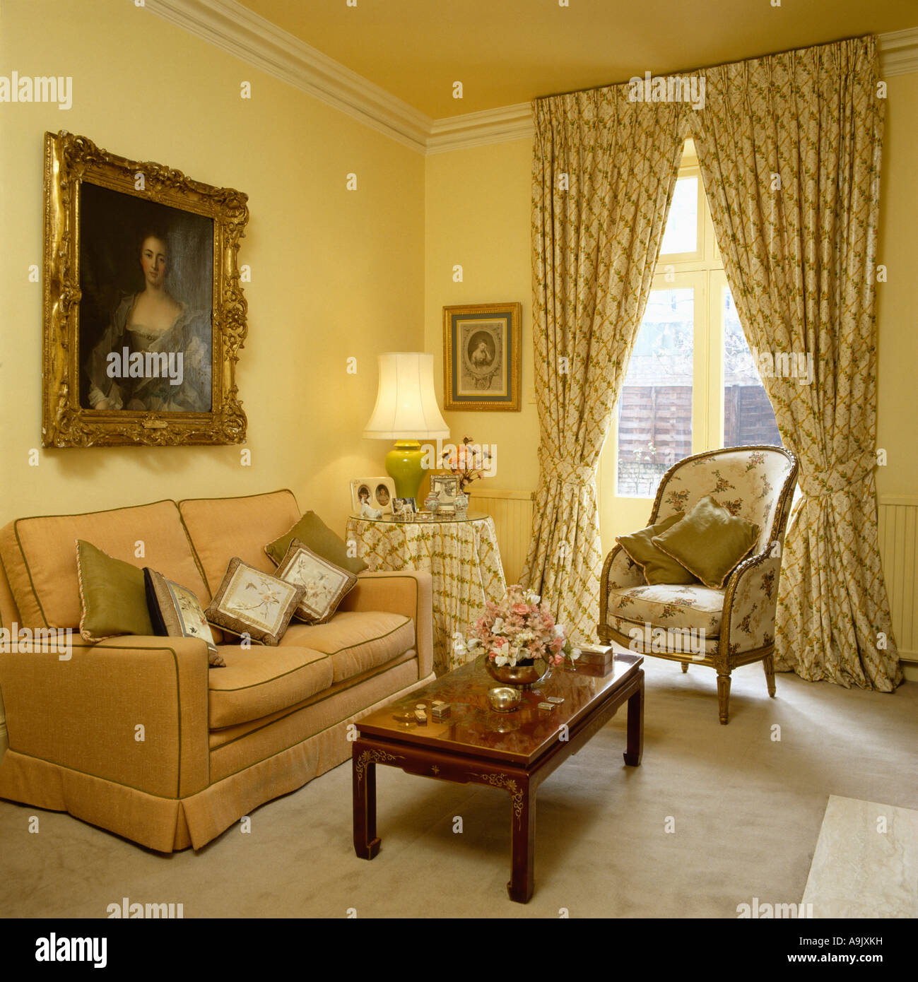 Large Portrait Above Peach Sofa In Pale Yellow Livingroom With Stock Photo Royalty Free Image