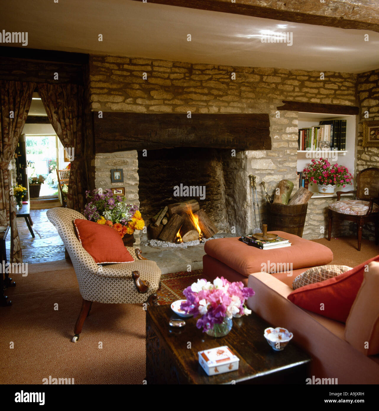Cottage Living Room With Fireplace inglenook fireplace in country cottage livingroom with stone wall